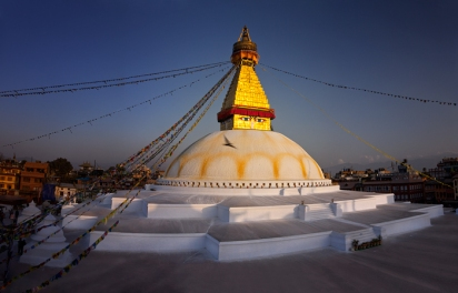 Sunset over the ancient stupa, one of the largest in the world and a social center for Tibetan Buddhism in Nepal.